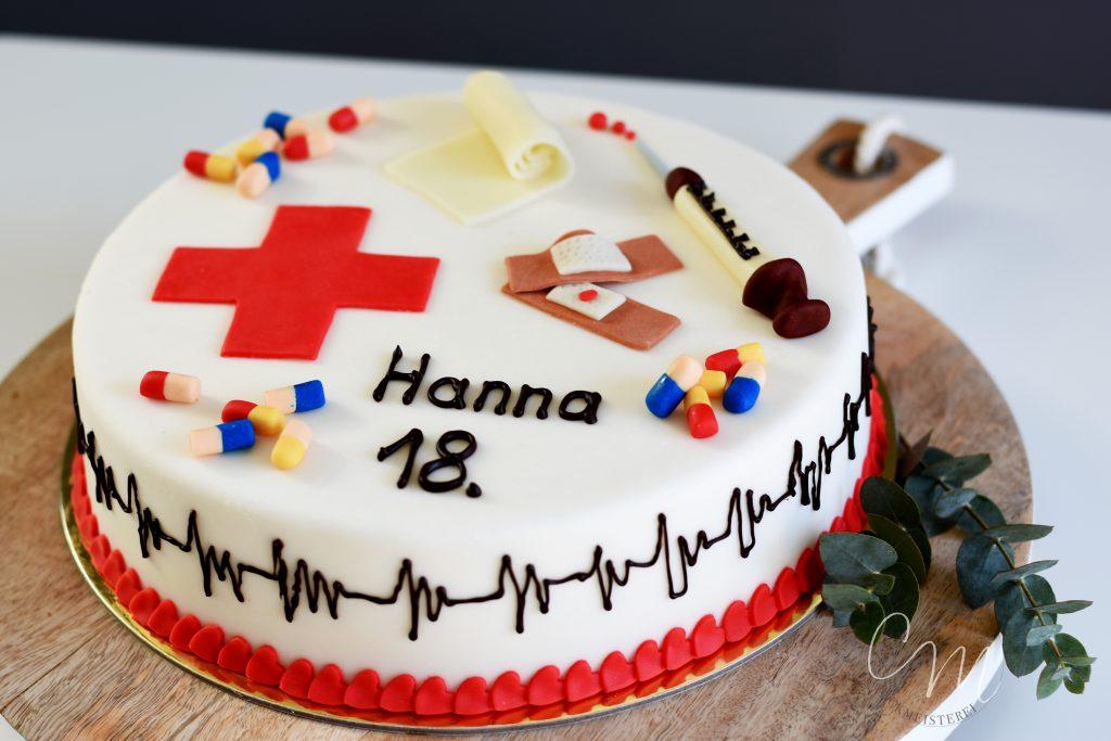 Torte zum Thema Geburtstag einer Krankenschwester mit Spritzen, Tabletten, Pflaster usw.